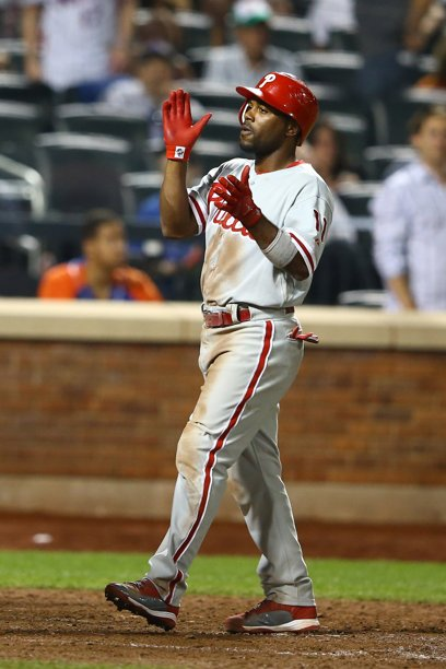 Jimmy Rollins celebrates 3-run homer. Jerk.