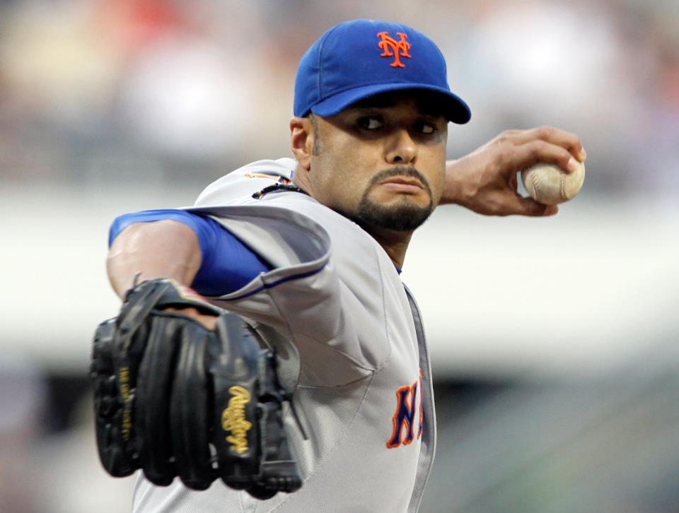 Johan Santana throws during Monday's game