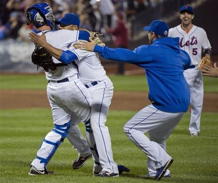 Johan Santana hugs Josh Thole after final out