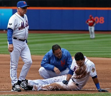 Ruben Tejada on the ground after getting hurt May 7