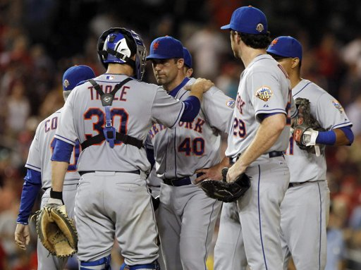 Josh Thole comforts Tim Byrdak after Tuesday's brutal outing