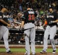 Giancarlo Stanton touches home after 2nd homer on the night