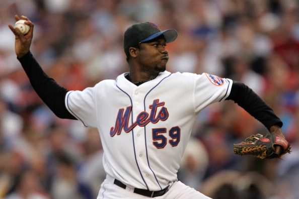 Guillermo Mota #59 of the New York Mets pitches against the Los Angeles Dodgers during game one of the 2006 National League Divisional Series at Shea Stadiujm, on Oct 4, 2006 in New York. The Mets defeated the Dodgers 6-5. (Photo by Chris Trotman/Getty Images)