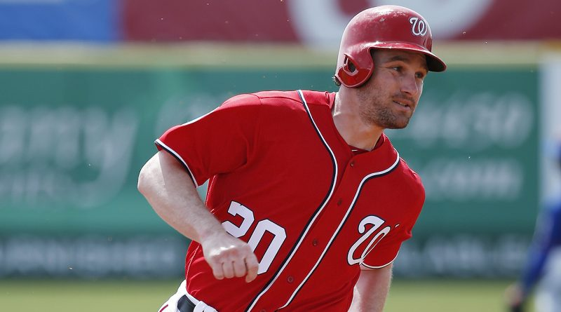 VIERA, FL - MARCH 3: Daniel Murphy #20 of the Washington Nationals heads toward third base on his way to scoring a run against the New York Mets after a single by Anthony Rendon in the first inning of a spring training game at Space Coast Stadium on March 3, 2016 in Viera, Florida. (Photo by Joe Robbins/Getty Images)